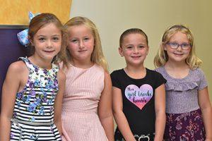 four girls in elementary hallway