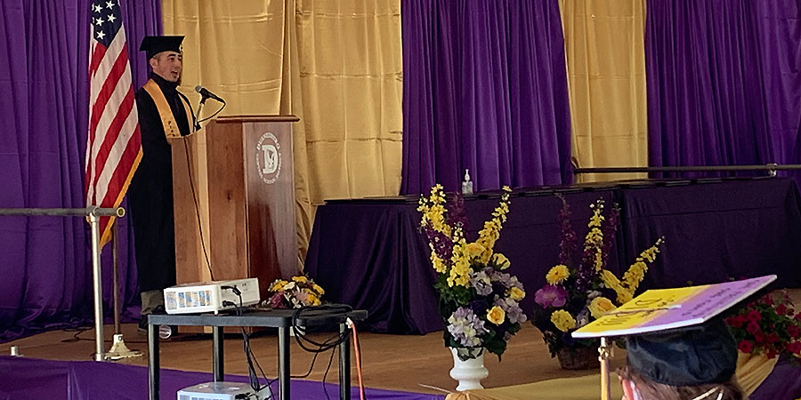 Aidan Enders speaks at graduation