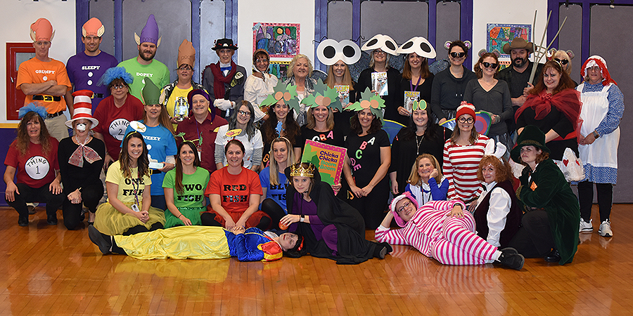 school faculty and staff drssed as literary figures on Halloween