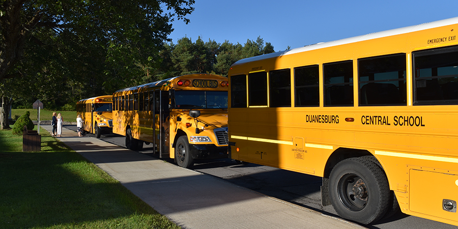 school buses parked in front of Elementary School