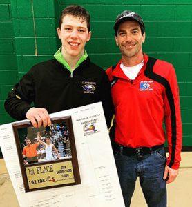 Zack holding plaque