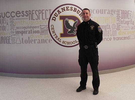 Deputy Reyell standing in HS hallway
