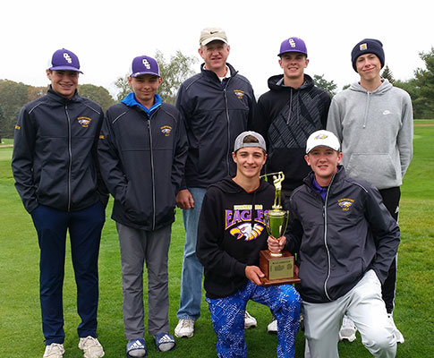 7 male golfers standing with 2 kneeling holding trophy