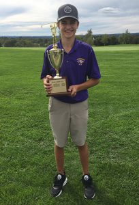 John Grant holds WAC trophy