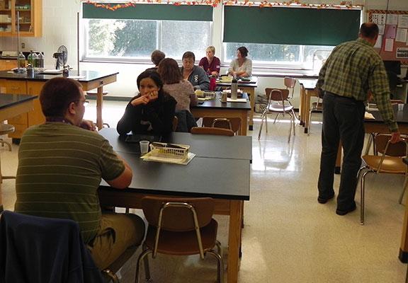 Teachers meeting in science room at Duanesburg High School