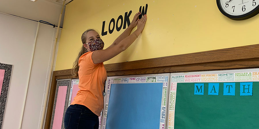 Ms. Ryan setting up her room