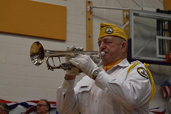veteran playing bugle