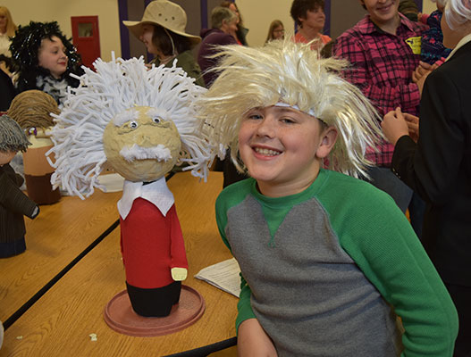 student with Einstein wig with his bottle project