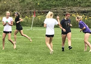 girls throwing water balloons
