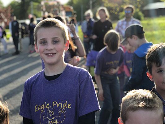 student smiling at parade