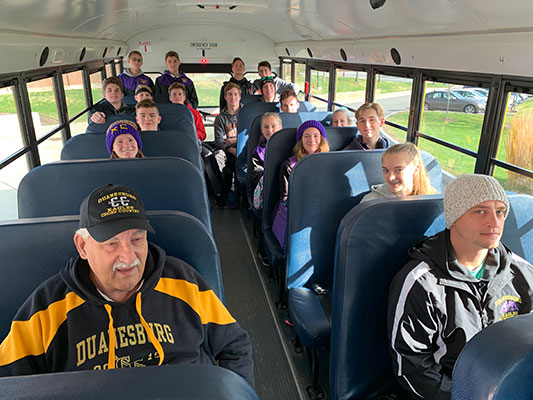 Cross country team members on school bus